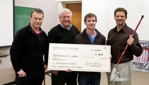 Winner, John Hall receives his check for my first sponsored project at KU.
